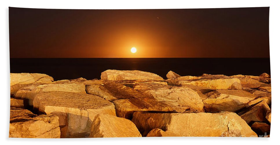 Beauty In Nature Bath Sheet featuring the photograph The Moon Rising Behind Rocks Lit by Luis Argerich