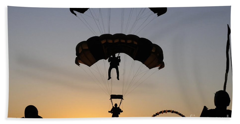 U.s. Army Golden Knights Hand Towel featuring the photograph The U.s. Army Golden Knights Perform An by Stocktrek Images