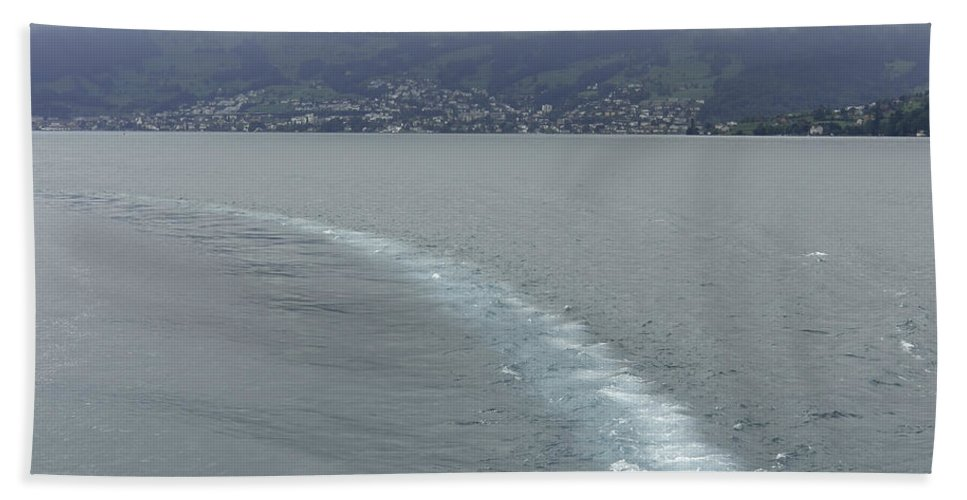Action Hand Towel featuring the photograph The Wake Of A Cruise Ship In Lake Lucerne by Ashish Agarwal