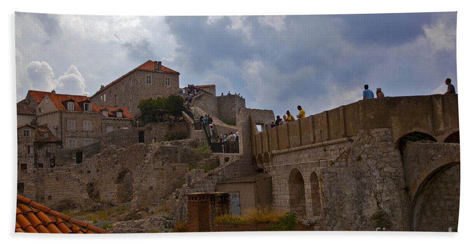 Dubrovnik Bath Sheet featuring the photograph They Walk The Wall In Dubrovnik by Madeline Ellis