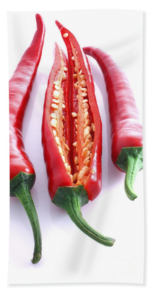 Seeds Hand Towel featuring the photograph Three Red Chilli's With One Cut Open by Simon Bratt Photography LRPS