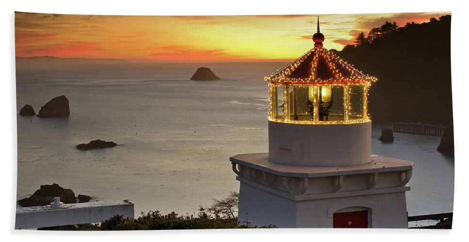 Christmas Lights Bath Sheet featuring the photograph Trinidad Memorial Lighthouse Sunset by Greg Nyquist