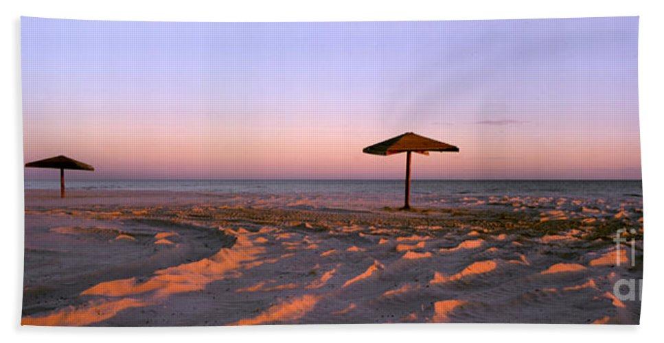 Beach Bath Sheet featuring the photograph Two Beach Umbrellas by Mike Nellums