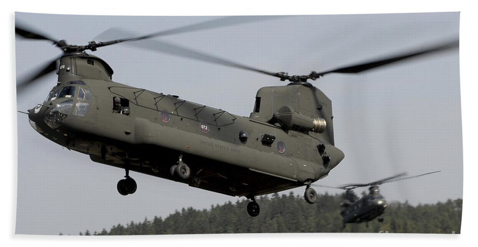 Army Hand Towel featuring the photograph Two Ch-47 Chinook Helicopters In Flight by Stocktrek Images