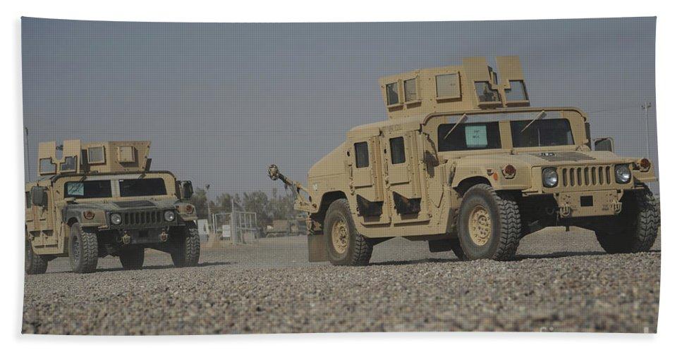 Horizontal Bath Sheet featuring the photograph Two M1114 Humvee Vehicles At Camp Taji by Stocktrek Images