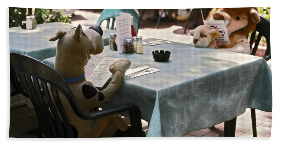2 Large Stuffed Animals Sitting Reading Menus Hand Towel featuring the photograph Unusual Diners by Sally Weigand