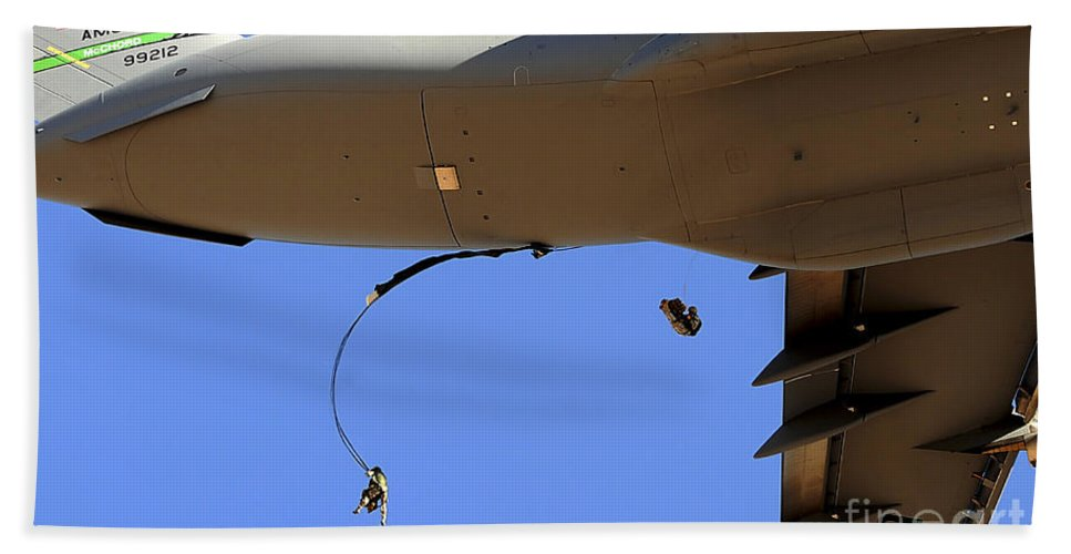 C-17 Hand Towel featuring the photograph U.s Air Force Airmen Parachute by Stocktrek Images
