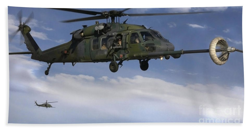 Horizontal Bath Sheet featuring the photograph U.s. Air Force Hh-60 Pave Hawks Conduct by Stocktrek Images