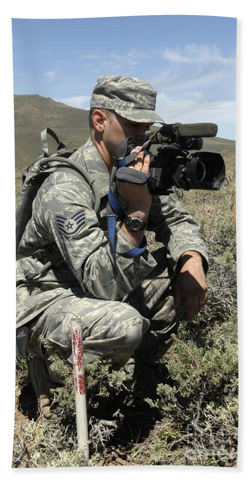 Us Air Force Hand Towel featuring the photograph U.s. Air Force Sergeant Shoots Video by Stocktrek Images