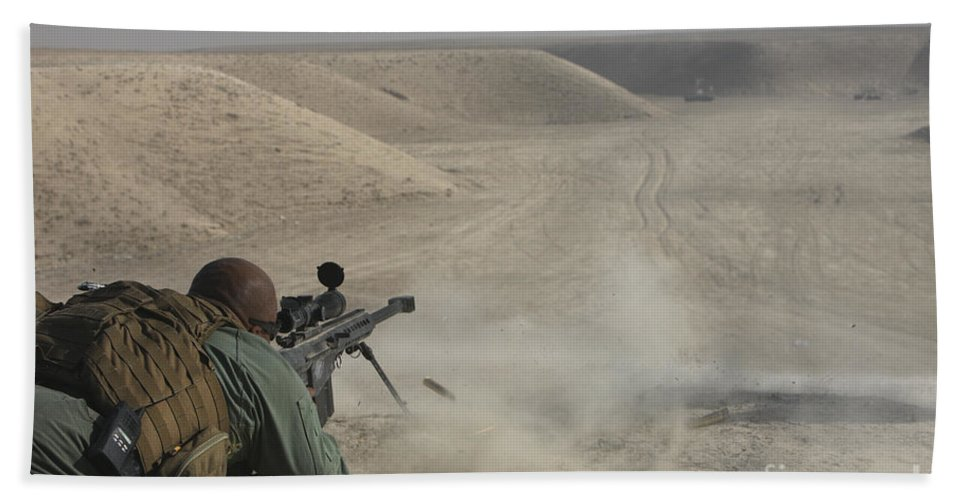 Isaf Hand Towel featuring the photograph U.s. Army Soldier Fires A Barrett M82a1 by Terry Moore