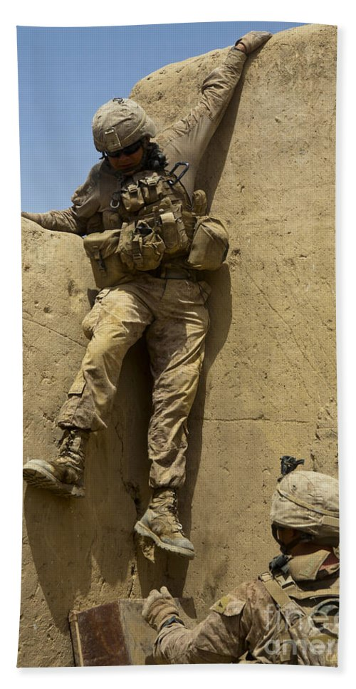 Afghanistan Hand Towel featuring the photograph U.s. Marine Climbs Down From An by Stocktrek Images