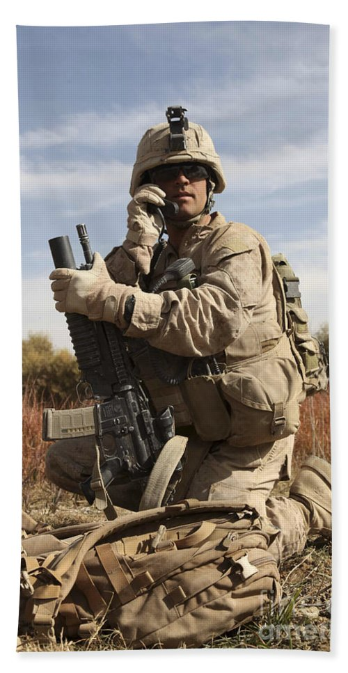 Soldier Hand Towel featuring the photograph U.s. Marine Communicates by Stocktrek Images