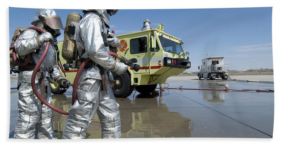 Protective Clothing Hand Towel featuring the photograph U.s. Marine Firefighters Stand Ready by Stocktrek Images