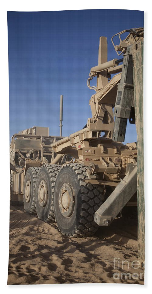 Operation Enduring Freedom Bath Sheet featuring the photograph U.s. Marine Uses A Logistics Vehicle by Stocktrek Images