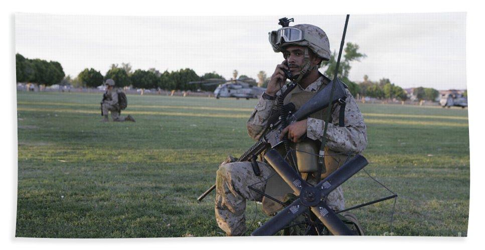 Us Marines Hand Towel featuring the photograph U.s. Marine Utilizes A Satellite Radio by Stocktrek Images