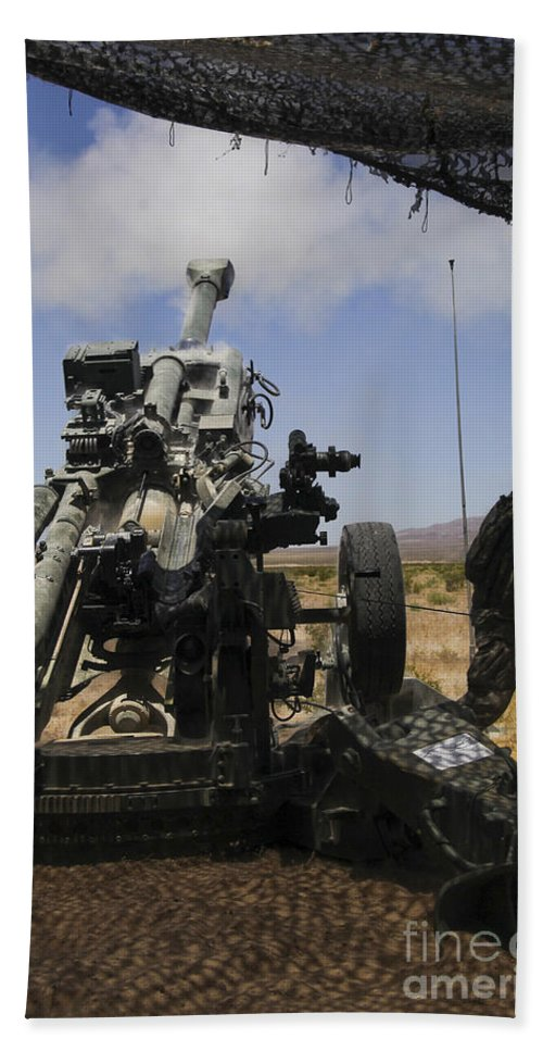 Weapon Bath Sheet featuring the photograph U.s. Marines Fire An M777 Howitzer by Stocktrek Images