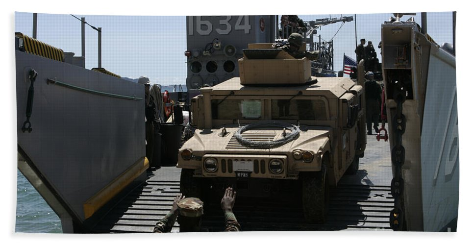 Marine Expeditionary Unit Bath Sheet featuring the photograph U.s. Marines Load An M1114 Humvee Onto by Stocktrek Images