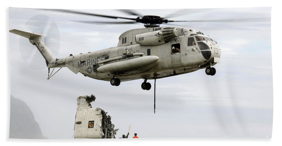 Emergency Hand Towel featuring the photograph U.s. Sailors Assist A Ch-53d Sea by Stocktrek Images
