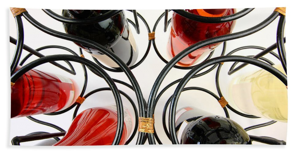 Wine Hand Towel featuring the photograph Wine Bottles In Curved Wine Rack by Simon Bratt Photography LRPS