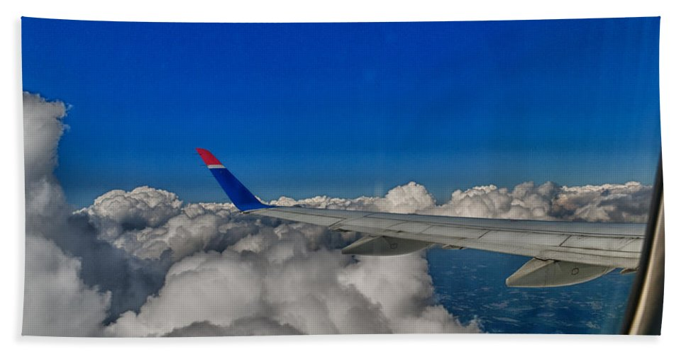 Airplane Bath Sheet featuring the photograph Wing And Clouds by Robert Swinson