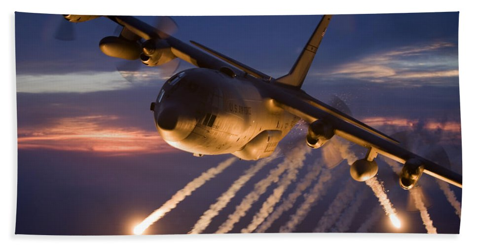 Smoke Bath Sheet featuring the photograph A C-130 Hercules Releases Flares by HIGH-G Productions