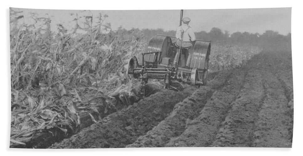 Farm Bath Towel featuring the photograph A Farmer Driving A Tractor by American School
