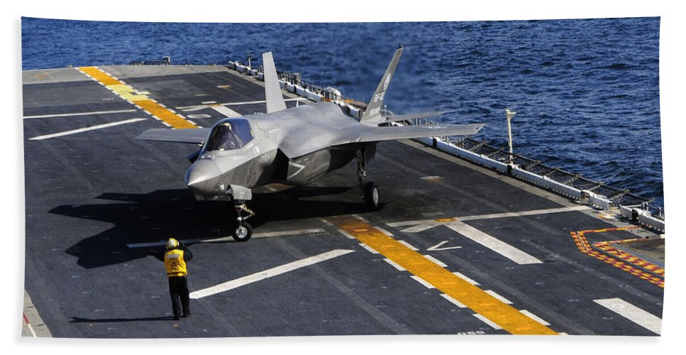 Stealth Hand Towel featuring the photograph An F-35b Lightning II Makes A Vertical by Stocktrek Images