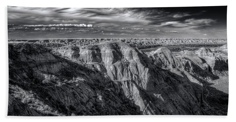 Badlands Hand Towel featuring the photograph Badlands by Wayne Sherriff