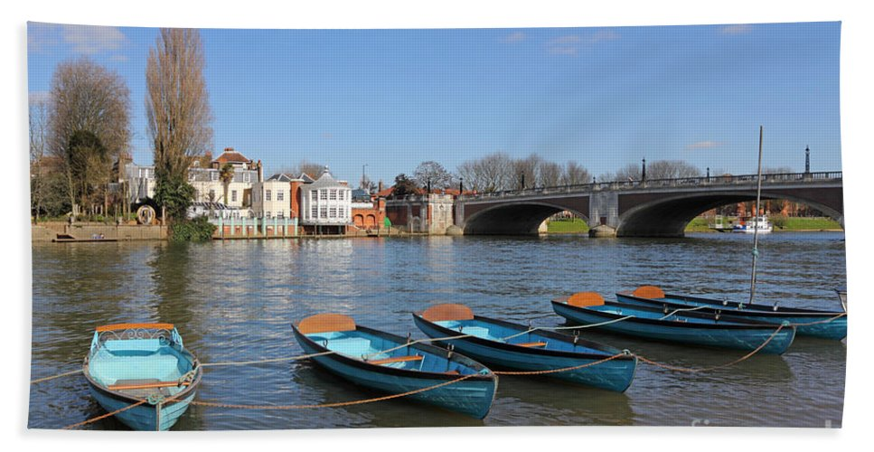 Blue Rowing Boats On The Thames At Hampton Court London Hand Towel featuring the photograph Blue Rowing Boats On The Thames At Hampton Court London by Julia Gavin