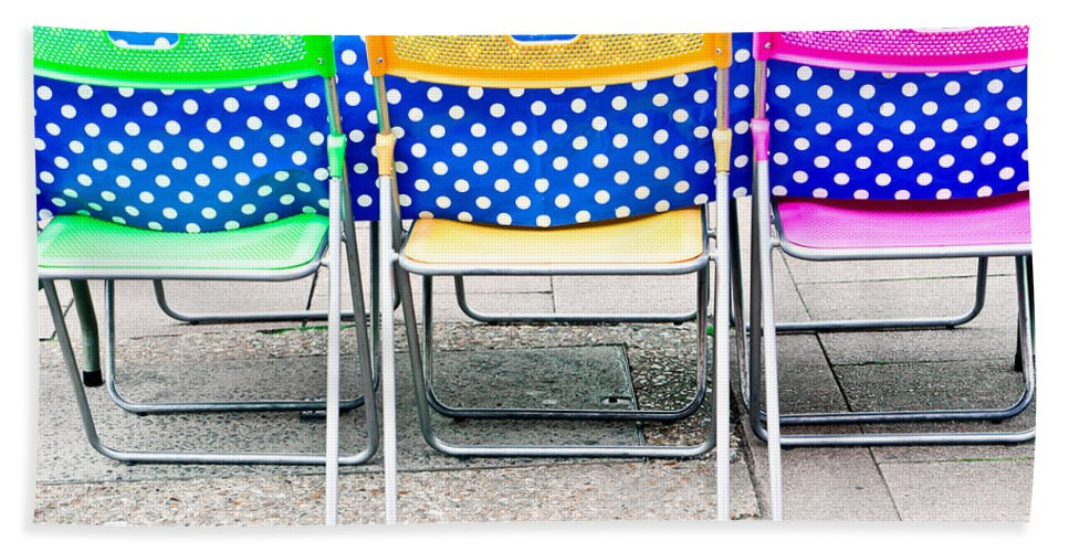 Al Fresco Hand Towel featuring the photograph Colorful Chairs by Tom Gowanlock
