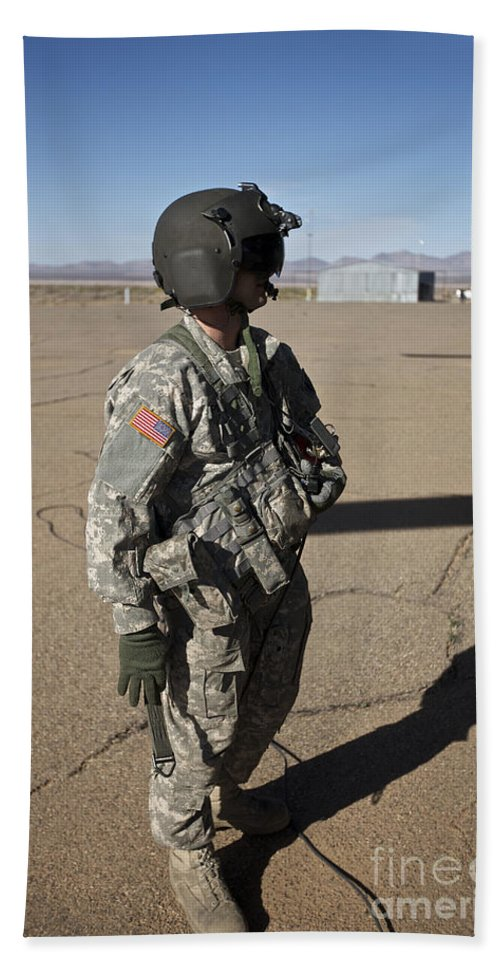 Exercise Angel Thunder Bath Sheet featuring the photograph Crew Chief Of A Ch-47 Chinook Stands by Terry Moore