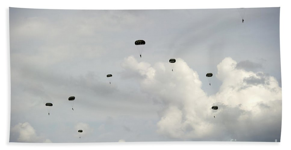 Soldier Bath Sheet featuring the photograph Halo Jumpers Descend To The Ground by Stocktrek Images