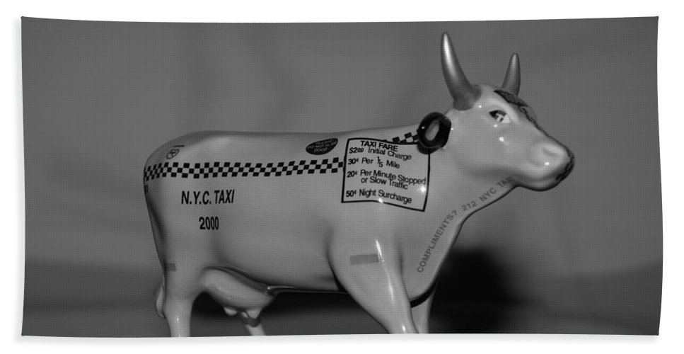 Macro Bath Towel featuring the photograph N Y C Taxi Cow by Rob Hans