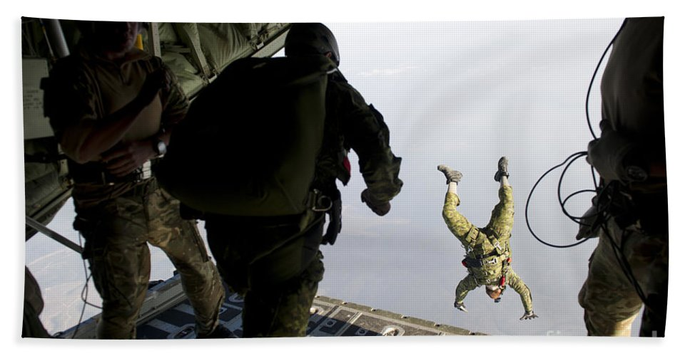 Soldier Bath Sheet featuring the photograph Special Operations Jumpers Exit A C-130 by Stocktrek Images