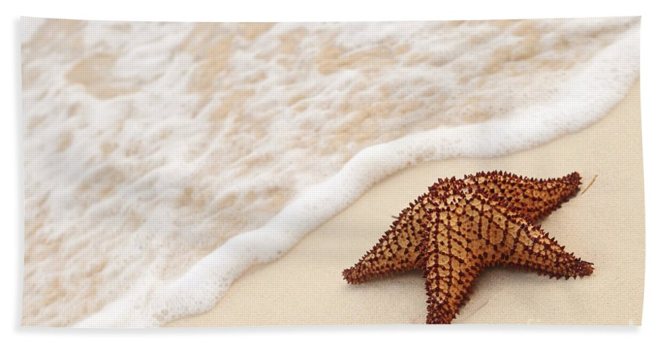 Starfish Hand Towel featuring the photograph Starfish And Ocean Wave by Elena Elisseeva