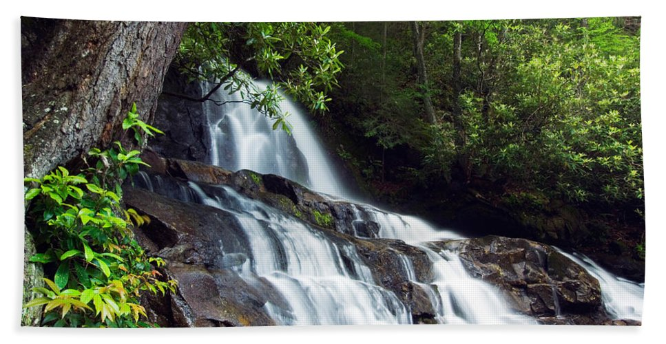 Photography Bath Sheet featuring the photograph Water Cascading Over Rocky Cliffs by Panoramic Images