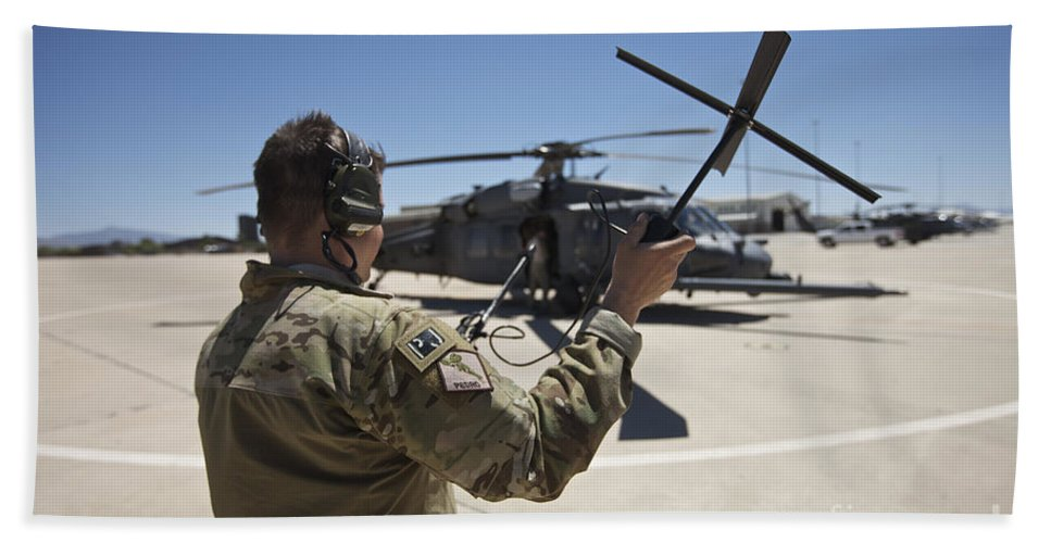 Exercise Angel Thunder Bath Sheet featuring the photograph Pararescuemen Conducts A Communications by Terry Moore
