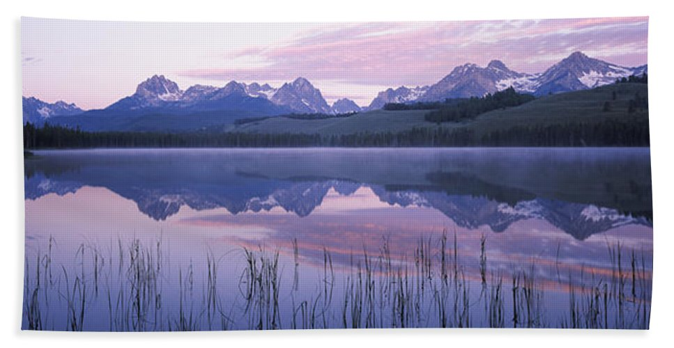 Photography Bath Sheet featuring the photograph Reflection Of Mountains In A Lake by Panoramic Images