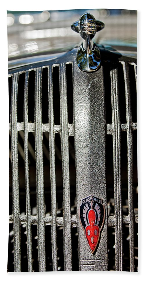 1936 Oldsmobile Hand Towel featuring the photograph 1936 Oldsmobile Grille by Jill Reger