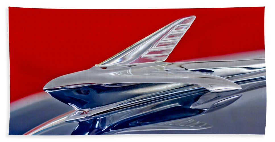 1951 Ford Woodie Hand Towel featuring the photograph 1951 Ford Woodie Hood Ornament by Jill Reger