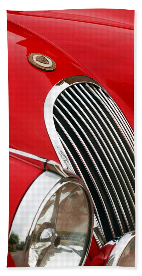 1952 Jaguar Xk 120 Hand Towel featuring the photograph 1952 Jaguar Xk 120 Grille Emblem by Jill Reger