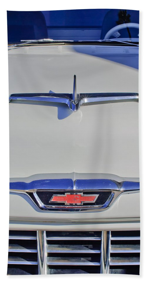 1955 Chevrolet 3100 V8 Hand Towel featuring the photograph 1955 Chevrolet 3100 Hood Ornament by Jill Reger