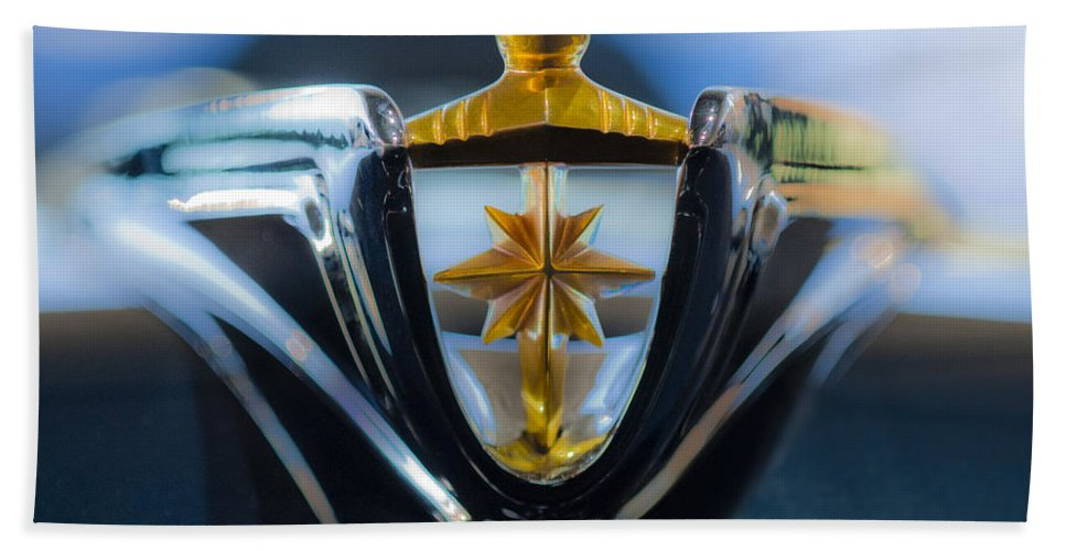 1956 Lincoln Premiere Convertible Hand Towel featuring the photograph 1956 Lincoln Hood Ornament by Jill Reger