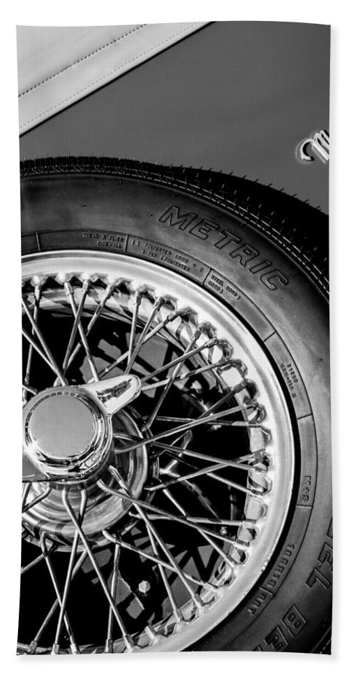 1964 Morgan 44 Spare Tire Emblem Bath Sheet featuring the photograph 1964 Morgan 44 Spare Tire Black And White by Jill Reger