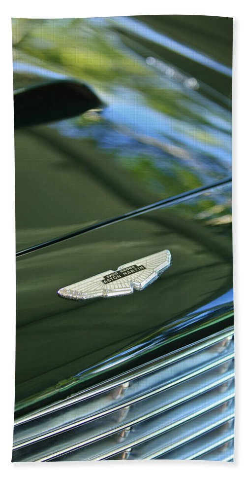 1967 Aston Martin Db6 Coupe Bath Towel featuring the photograph 1967 Aston Martin Db6 Coupe Hood Emblem by Jill Reger