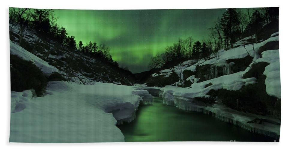 Green Bath Towel featuring the photograph Aurora Borealis Over Tennevik River by Arild Heitmann