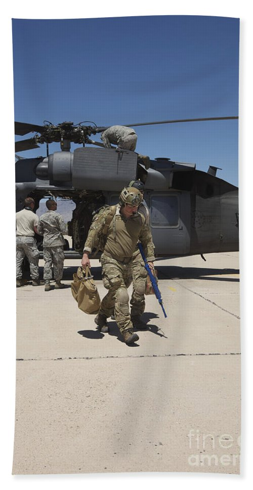 Exercise Angel Thunder Bath Sheet featuring the photograph Pararescuemen Walks Away From A Hh-60g by Terry Moore