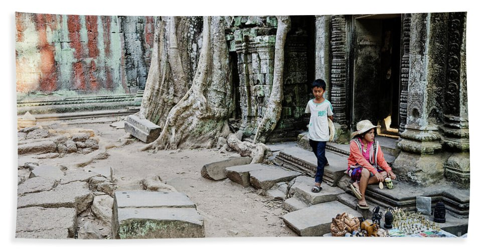 Angkor Bath Sheet featuring the photograph Souvenir Trinket Stall Vendor In Angkor Wat Famous Temple Cambod by Jacek Malipan