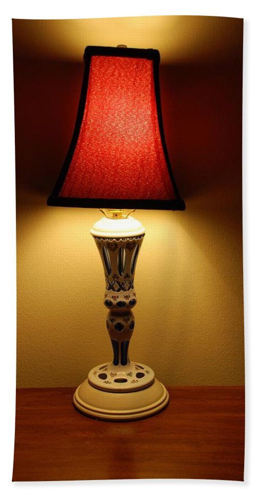 Lights Hand Towel featuring the photograph The Lamp by Rob Hans