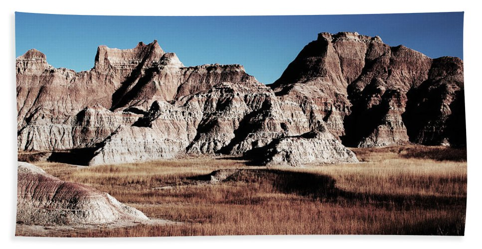 Landscape Hand Towel featuring the photograph Badlands At Sunset by Glenn W Smith